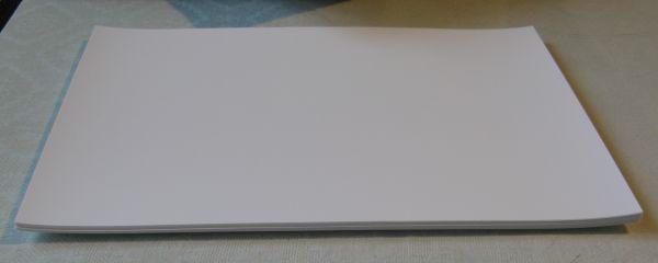 Zakrzywiony papier foto zawadza o g�owic� - jak wyprostowa�?