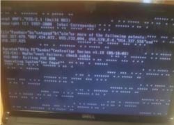 Dell Inspiron 1564 - Dziwne znaki na ekranie przy włączaniu kompa (nie artefakty
