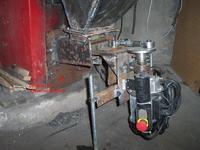 Podajnik szufladowy/tłokowy pieca węglowego