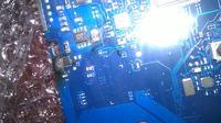 Samsung Np200a5b - NIe ładuje baterii - spalony element na płycie głównej