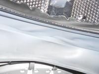 Samsung 0600NXW - uszkodzony fartuch