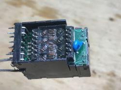 Wnętrze gniazd RJ45 ze zintegrowanym transformatorem sygnałowym