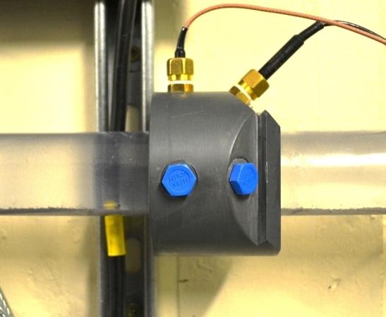Mierzenie pr�dko�ci szlamu p�yn�cego w rurach metod� akustyczn�