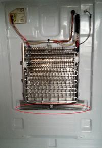 Samsung RF62HERS - Woda zbiera się na dole lodówki