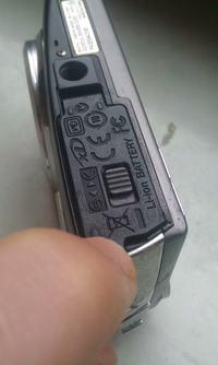 Kupi� klapk� do baterii aparatu Olympus mju 1010